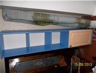 Барнаул: Детский уголок Продам детский уголок в очень хорошем состоянии. Кроватка-маятник 3 уровня с выдвижными ящиками. Шкаф угловой и шкаф книжный, цвет сини
